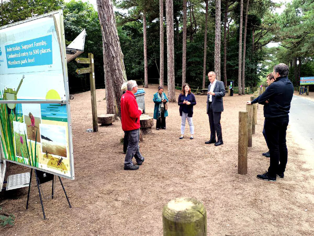 Bill Esterson MP, Emily Spurrell and Steve Rotheram speak with members of the public and volunteers at National Trust Formby.