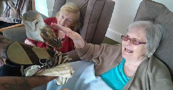 Residents Louisa Delacruz (L) and Ellen Sayonas (R) get friendly with the beautiful birds.