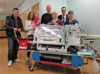 Picture shows, from the left, Milly and Steph Beqo with daughter, Mia; Andrew and Sarah Malm; Simon Featherstone, Director of Nursing and Quality; Sister Karen Wareing, Neonatal Ward Manager