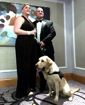 Dog handler Constable Steve Adams with his wife, Joanne, and Champ.