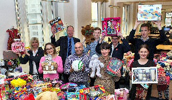 Chief Executive Ged Fitzgerald (back row, far left) with charity champions and representatives of organisations benefiting from the Christmas Gift Appeal.