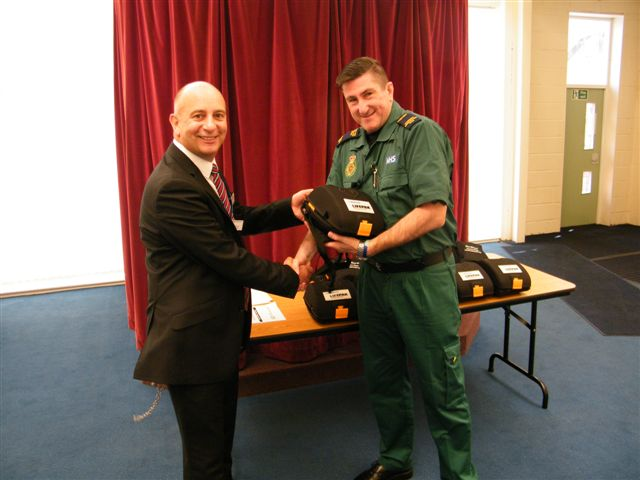 HMP Kennet Deputy Governor Robbie Durgan receiving the defibrillators from NWAS Community Resuscitation Development Officer Rob Sharples.