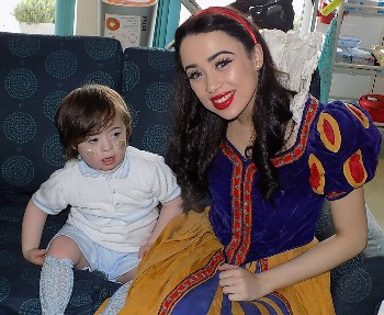 Georgia Austin, star from Snow White, with the children, parents and staff at Zoë's Place Baby Hospice in West Derby.