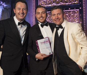 From L-R � Compere at the Liverpool City Region Tourism Awards 2016, Andrew Dickens, pictured with Josh Boyd from Orb CIC and Andrew Dwerryhouse from Wild Thang who sponsored the award.