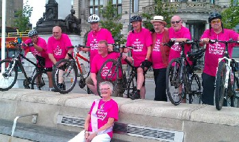 Photo caption: Steve (third left) and his team after their first bike ride for R Charity, with his wife Barbara (front)