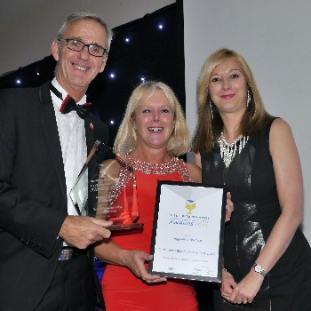 NWC AHSN Chief Executive Dr Liz Mear is pictured with the Supplier of the Year Awards 2015 winners Lee and Helen Townsend from NHS Blood Bikes, Lancs and Lakes