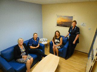 Photo caption: Cheryl and Lisa from Community Link Foundation with hospital staff in the new relatives� room.