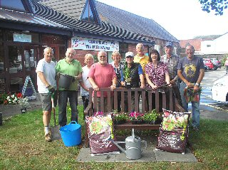 Staff and volunteers at Ainsdale Community Care ready to transform their garden for 150th Anniversary.