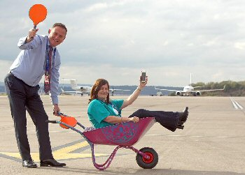 LJLA�s CEO Andrew Cornish and HR and Community Director Carol Dutton already in training for the Airport�s wheel barrow race that will help raise funds for Alder Hey�s digital �app�.