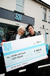 Co-op Store Manager Helen Horsley supporting the Christmas lights with Councillor Denise Dutton