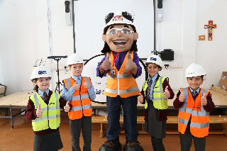 Honor Goodsite giving a lesson in site safety to children from Faith Primary School.
