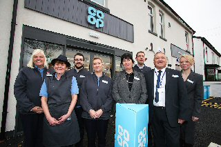 L-R : Kelly Wright, Eileen Scarsbrick, Jack Sefton, Lisa Weatherby, Helen Horsley, Ronnie Mann, Mike Clegg and Jean Marie Hughes at the opening of the new Co-op store in Formby