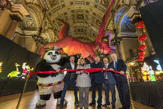 From l-r ALL LIT UP: Po the Panda; Allan Leech, Director, Heritage Brand Ventures; Cllr Wendy Simon, Assistant Mayor, Culture; Chris Brown, Director, Marketing Liverpool; Peter Johnson-Treherne, Director, Heritage Brand Ventures; Alan Smith, Manager, St George�s Hall.