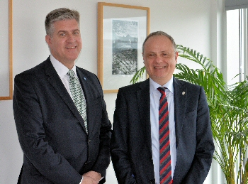 Dr Ian Barwick (Chief Scientific Officer, Proton Partners International) and Professor Anthony Hollander (Associate Pro Vice Chancellor for Enterprise, University of Liverpool).