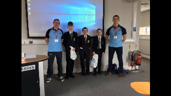 Year eight pupils from Mosslands School (who were runners up for the best team during their STEM workshop): Joseph Ryan, Joshua Pritchard and Finlay Joyce ? pictured with Flight Sergeant Mick Brooks (left) and Flying Officer Cameron-Johnson (right).