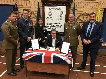 Photo attached � Metro Mayor Steve Rotheram (seated centre) signs the Liverpool City Region Armed Forces Covenant with (from left to right) Lieutenant Colonel Tim Gould - Commanding Officer 156 Transport Regt, Squadron Leader Lee Rimmer - RAF Woodvale, Commander Judith Barnes - HMS Eaglet, Colonel Ray Hughes - Headquarters NW, and Veterans HQ Chief Executive Bob Blanchard.