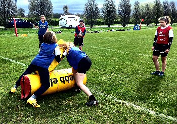 Girls take part in drills at Sale Sharks� summer residential camp.