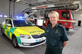 A paramedic who brings Christmas cheer to pensioners has reached the final of the Amplifon Awards for Brave Britons...