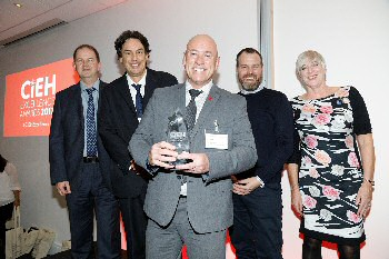 Pictured collecting the award are, from left to right, Ian Doig (Environmental Health), Gareth Hill (Public Health) and Jon Hardwick (Environmental Health) with Mark Byrne (from award sponsor, Grafton Empty Homes) and Ann Godfrey (Chief Executive of the CIEH). Please by �Barney Newman�