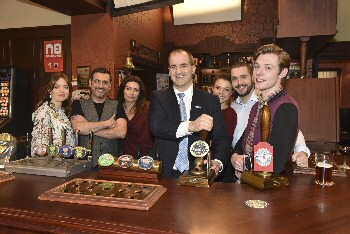 Jake Berry, Northern Powerhouse Minister, pulls a pint in the Rovers Return with the Coronation Street cast.