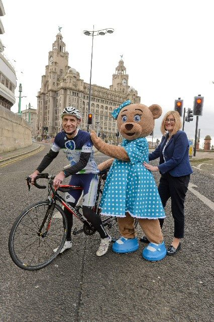 Liz Chandler, Director of Corporate Development at Merseytravel; Claire Bear, Claire House Children's Hospice Mascot; Mark Sandamas, Director of Pennine Events Ltd