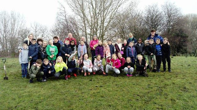 Photo shows children from Northcote School with teachers, Friends of Walton Hall Park volunteers and staff from Mersey Forest.