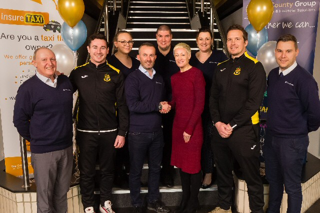 Southport FC Chief Executive Natalie Atkinson, striker Josh Hine and manager Kevin Davies are seen with The County Group Chief Executive Kevin Catterall (centre) and management team members Gary Fennah, George Wall, Ellie Forster, Karl Garcia and Jennie Jackson at the opening of the new centre of excellence.