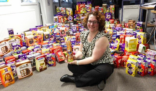 BEST NEST: Liverpool City Council Charity Champion Lisa Flynn surrounded by some of the hundreds of chocolate Easter Eggs collected by council staff.