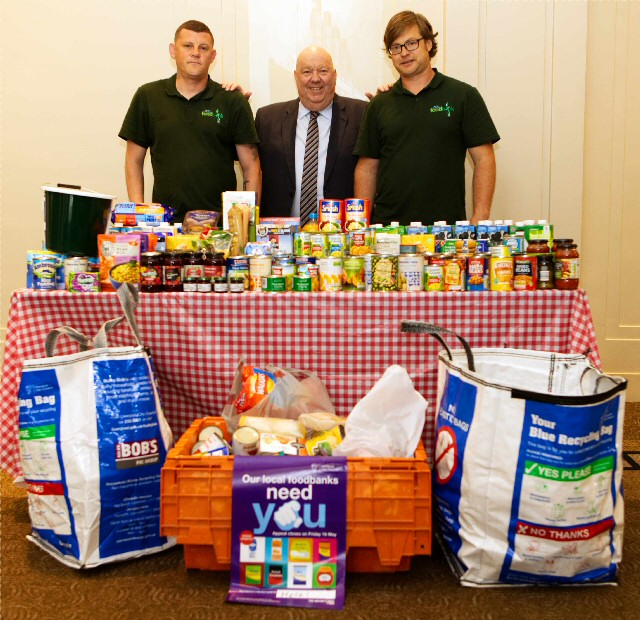 Mayor of Liverpool Joe Anderson shows just part of the city council food collection Simon Huthwaite and foodbank volunteer Stephen Middleton.