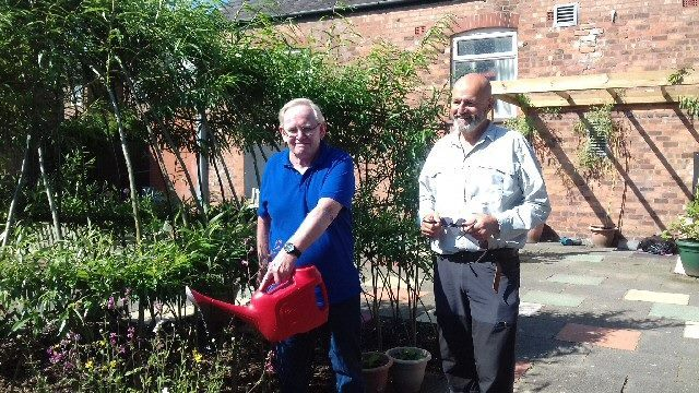 Andrew (right) and fellow men's group member Mike Rimmer enjoy a sunny spot in the garden at Southport Community Centre