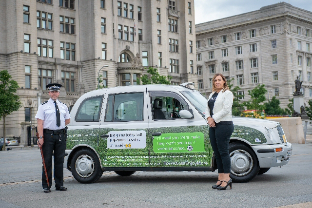 Inspector Andy Greer from Merseyside Police with Jenny Davies from Liverpool City Council�s Alcohol and Tobacco Unit and one of the branded taxis promoting Drink Less Enjoy More during the World Cup