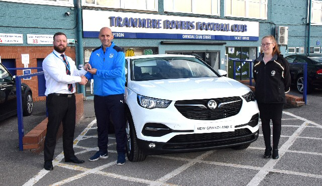 New Car Sales Manager Matt Edwards hands over the keys to Tranmere Rovers Assistant Coach Shaun Garnett, along with Super Whites fan Gabrielle Porter, sales consultant.