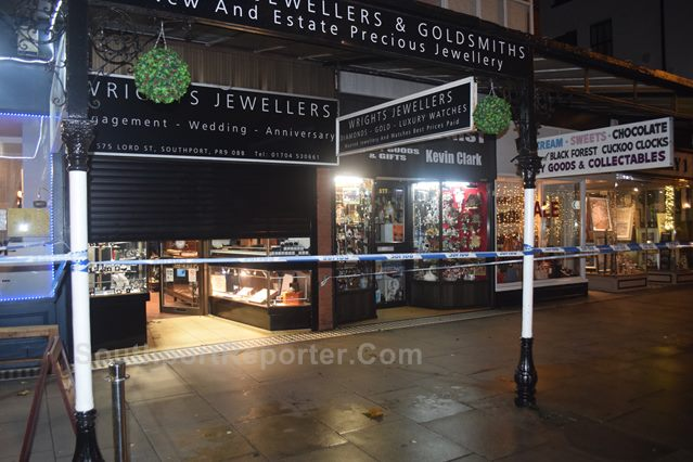 Photograph shows Police cordon tape front of Wright�s Jeweller, Southports.