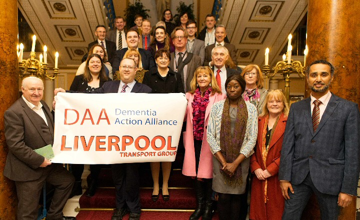 Photo - Motion Carried -- Councillor Jeremy Wolfson, Mayoral Lead for Older People (South) is joined by representatives from the Dementia Action Alliance's Transport Group, including Pat Broster and Tommy Dunne and Liverpool City Councillors at this week's full Council meeting where the motion on Age Friendly Liverpool was debated.