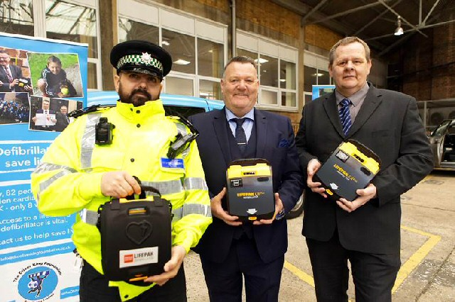 Lifesaver: Liverpool City Council Licensing Officer Aziz Musa, Mark King of the Oliver King Foundation and city council training officer Karl Lloyd with the new defibrillators.
