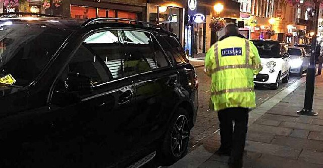 On Patrol: City Council Licensing Officers checking vehicles in the City Centre.