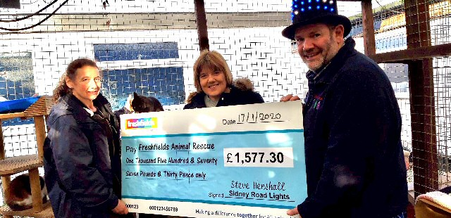 Photo caption:- Picture shows Helen Stanbury, Freshfields Director with Steve Henshall and his wife Jan, along with the cheque
