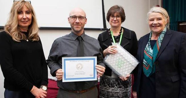 Quality Counts: Adam Kewn accepts the Attendance Mark on behalf of Heygreen Primary School in Wavertree from Carolyn Harkness from the attendance mark scheme, Gail Porter from Liverpool City Council and Cllr Barbara Murray.